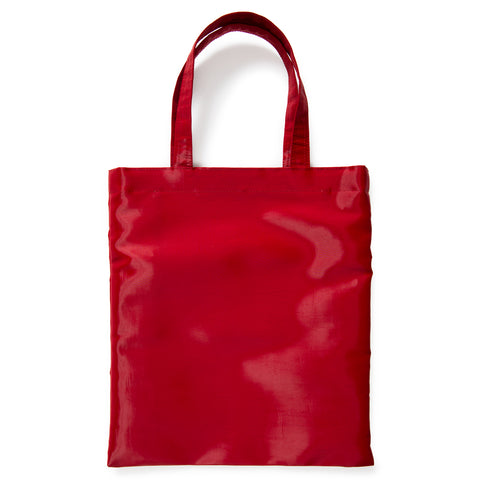 A bright red carrying bag with a rectangular shape, crisp construction, shimmery surface and sturdy twin loop handles.