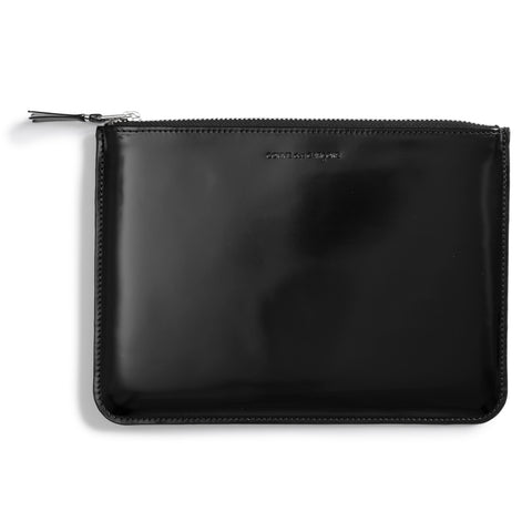 A flat black pouch with top zip. The brand name is embossed on the top boarder of the pouch.