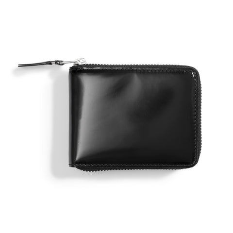 A black rectangular leather wallet with all around zip