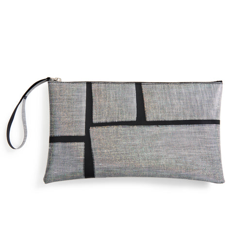 Flat lay of a shiny rectangular pouch with a loop wrist strap at the top let corner. The pouch is black with large patches of woven, iridescent material embedded in it. There is a zipper along the long, top edge.