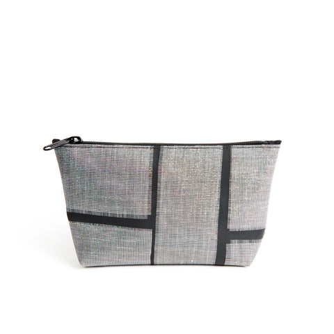 A shiny pouch with a zipper on the top long edge. The pouch is black with large patches of woven, iridescent material embedded in it. It is almost rectangular, with a longer top than bottom. It stands up.