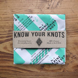 Know Your Knots Bandana in a paper band package.