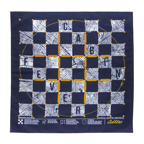 Cabin Fever Game Bandana in navy with white and yellow graphic detail. The graphic depicts a board game in a wood grain design.