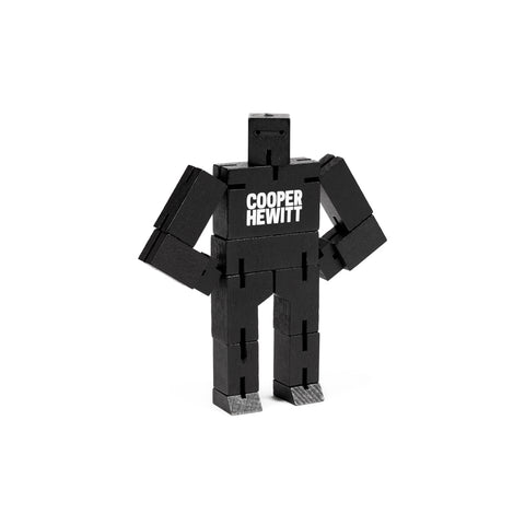 Exclusive black Micro Cubebot in standing position white Cooper Hewitt logo on chest.