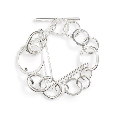 This bracelet consists of 18 silver elements; circular rings and oval of different sizes pierce one another creating an unusual geometric pattern.