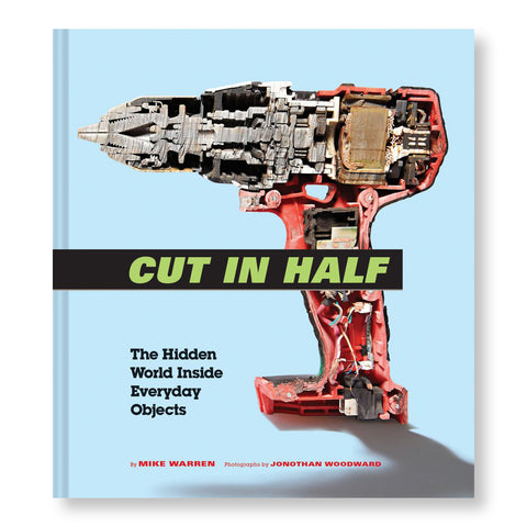 Light blue book cover with a red and gray power drill in profile that has been sliced straight down in half showing complex mechanics and wires