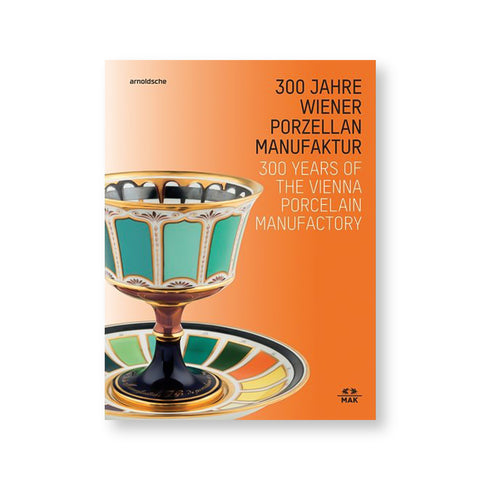 White and orange gradient book cover with porcelain goblet and dish featuring delicate ornamentation and swatches of many colors