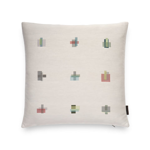 Eggshell colored square-shaped pillow with 9 embroidered patchwork squares detailing
