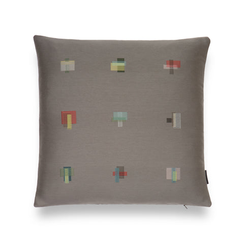 Dark gray colored square-shaped pillow with 9 embroidered patchwork squares detailing