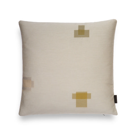 Light colored square-shaped pillow with 3 patchwork embroidery detailing