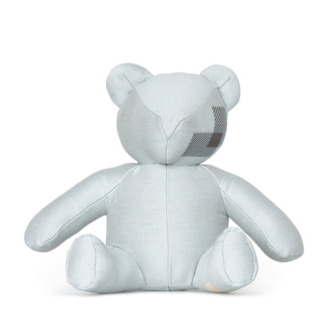 Front view of glacier colored teddy bear with patchwork detail on right side of face