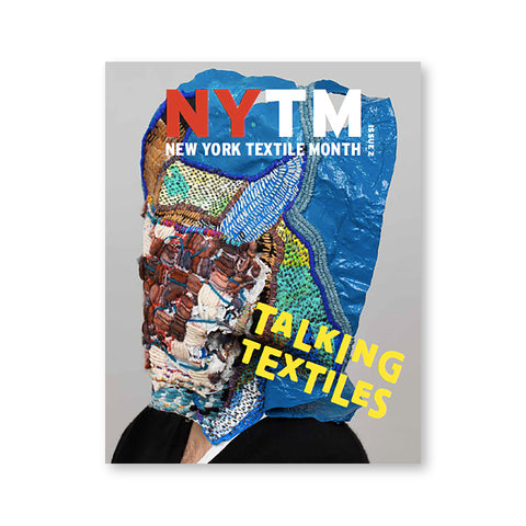 Magazine cover with figure wearing mutli media textile covering their head with many colors and textures. Magazine logo at top in white and red letters and magazine title in jumbled yellow letters near bottom