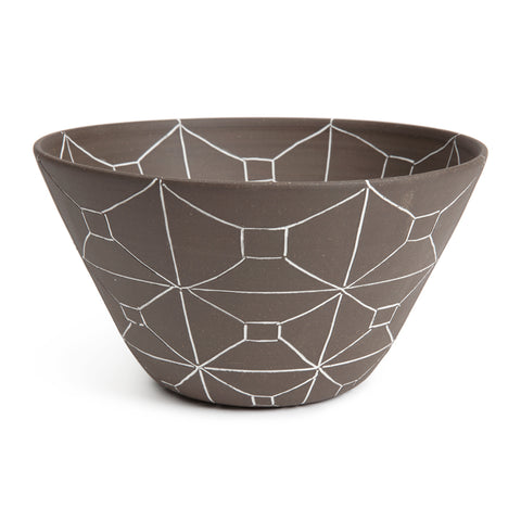 Large matte brown bowl that flares outward toward the top and has a rectangular etched out pattern in white.