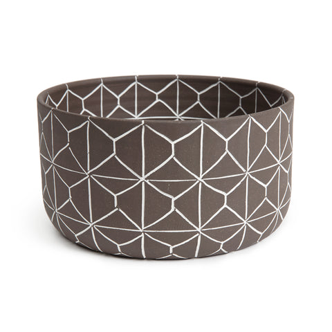 Matte brown ceramic bowl with tall sides and an etched out white geometric pattern