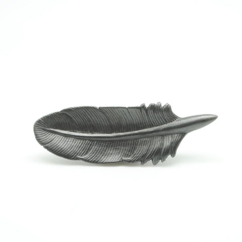 A Graphite Quill sits on its side and faces forward, showing the delicately carved details.