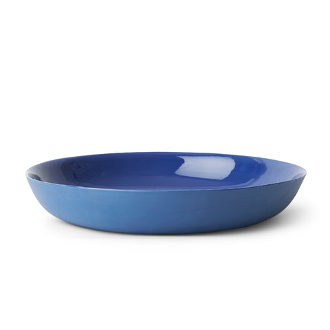 Flat glazed porcelain bowl with flared rim in blue.