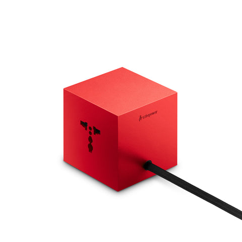 Red resin cube with different openings for charges on three sides, black textile cord.