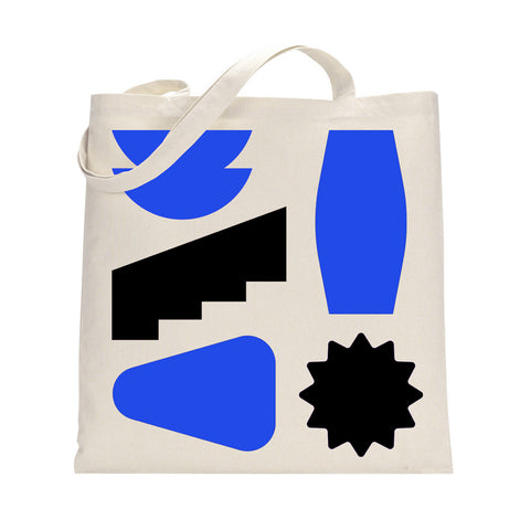 White tote bag with three blue shapes, and two black shapes.