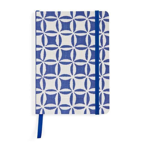 Rectangular notebook decorated with a graphic pattern of blue circles and squares over light gray background.