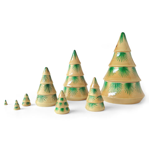 Spruce MatryoshkaEight adorable nesting dolls in the shapes of spruce trees. Plain varnished linden wood decorated with green sprays of pine needles.