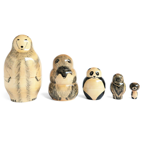 Adorable series of five nesting dolls featuring a polar bear, brown bear, panda, moon bear, and Russia's beloved Olympic mascot Misha bear. Hand-painted on linden wood, with  delicate black accents and line drawings.