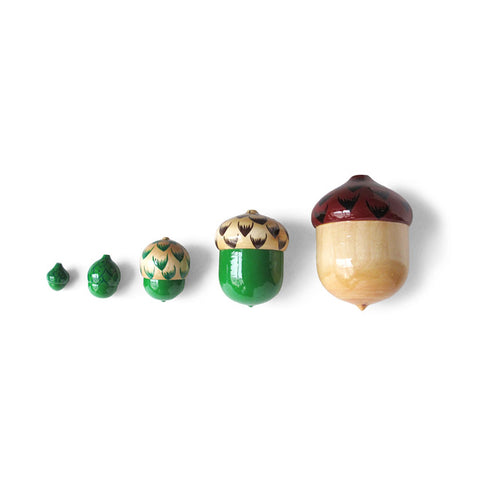 Oaknut Matryoshka. The series of dolls depicts five different oak nut acorns, hand painted  with decorated caps and solid green or natural linden wood bodies.