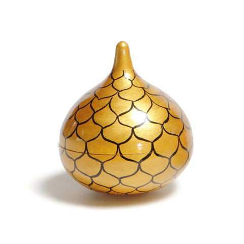 A hand-painted bell shaped like an onion with a peaked top and shiny gold lacquer surface decorated with an interlocking net of black lines resembling chain mail.