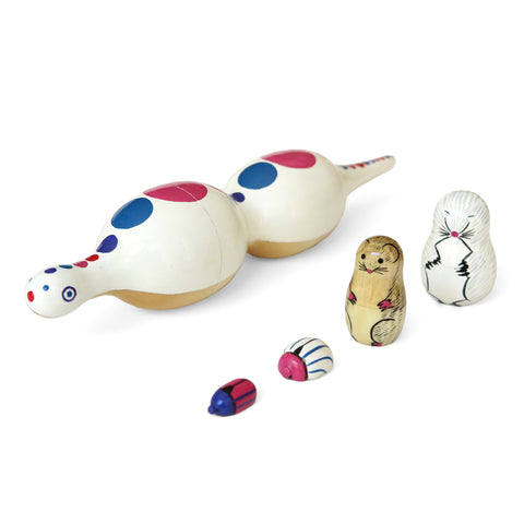 Snake Matryoshka.  This colorful nesting doll has two bellies. One contains a mole, the other a field mouse, each with a beetle inside.