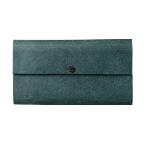A rectangle shaped envelope style wallet made out of a cloth material and featuring a brass snap closure.