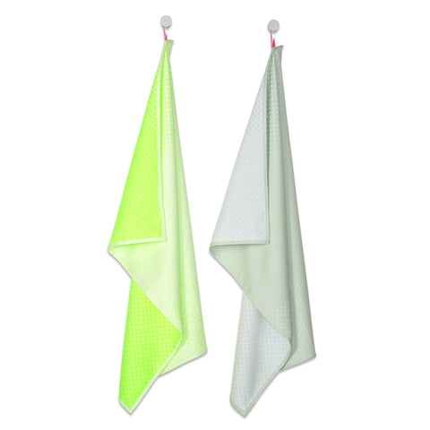 Two tea towels in a fluorescent green light sage green color.