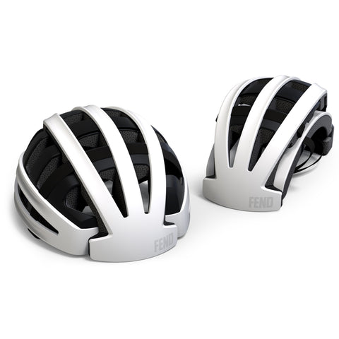 An image of two white Fend bike helmuts. One is shown in its collapsable position while the other is shown open.