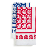 Two towels feature a vibrant pattern of graphic houses win red and blue colors, printed over white-chalk cotton.