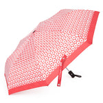 Open umbrella features graphic neat pattern of sequences with dots inside in red color.