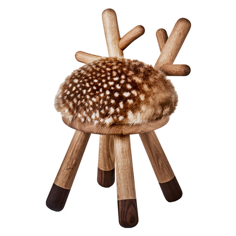 The chair is formed like small antlers and the seat is upholstered with brown faux fur including the small white dots giving it its characteristic appearance of deer.