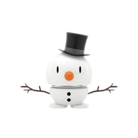 Short snowman with a black top hat, small black eyes, an orange nose, twigs for arms, two black buttons on the body, and two feet.