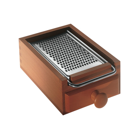 Cheese grater shot on white background, bade of wood with steel grater as lid and pull-out drawer to catch shavings.