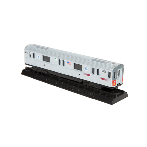 Side view of silver toy subway car attached to a piece of track. An American flag is printed on the side of car.