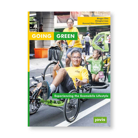 Book cover with photograph of three family members one on a bicycle one on three-wheeled peddled vehicle towing their child on a busy street scene. Title in white letters in yellow and green fields