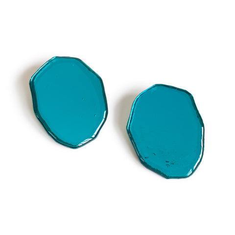 Reverberation Earrings; transparent electric blue lucite earrings, hand made into ovals.