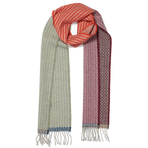 Lambswool Patchwork Scarf, Orange, combining a trio of contrasting patterns woven in alternating bands throughout the length of the scarf.
