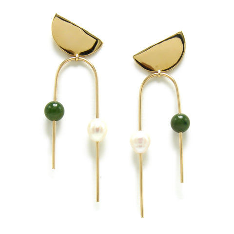 Jade and Pearl Pilar Earrings; An asymmetrical upside down U shaped thin gold plated rod. A Jade and white pearl Bead rest on the left and right side of the thin gold plated rod, which has moving linear components that add a playful sleek look.