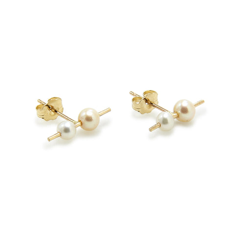 Pearl Orion Double Studs; gold stud with two spheres along an axis