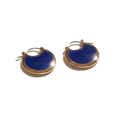 Small hoop earrings made of Lapis Lazuli with a brass trimming.