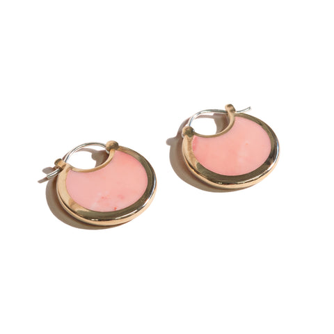Small hoop earrings made of Pink Opal Mojave with a brass trimming.