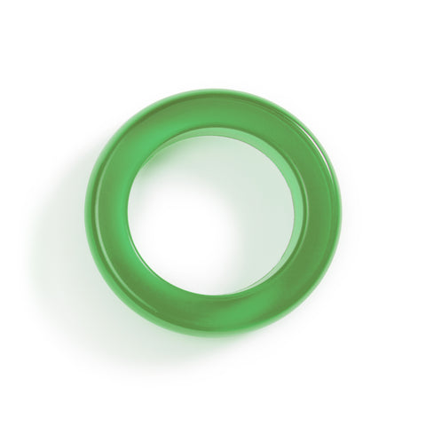 Frontal view of a translucent green bracelet, a simple circle of medium-thick silicone on a white background