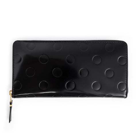 Patent Leather rectangle wallet, including full zip, with embossed circle detail.