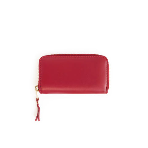 A rectangular-shaped, full zip leather coin purse in red.