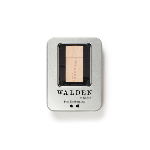 A rectangular metal tin with rounded edges and a window revealing the natural wood USB game plug inside. The Walden game logo is imprinted in black under the window.