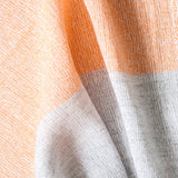 Closeup shot of the shukin towel in pastel orange and gray