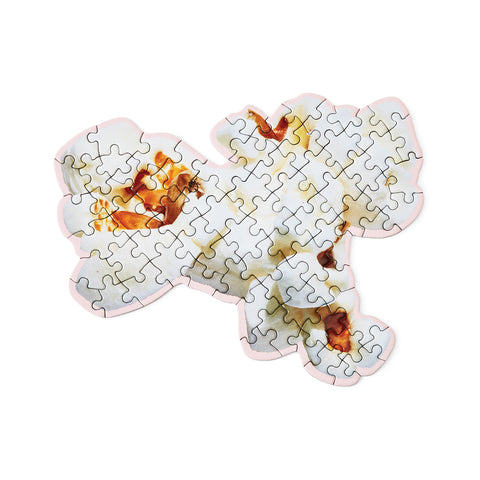 An assembled puzzle in the shape of a piece of popcorn..